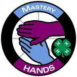 Graphics of a circle with the silhouette of a pair of hands in the middle.  The word Mastery is at the top of the circle and the word Hands is at the bottom.  This represents the Hands portion of the 4-H pledge.