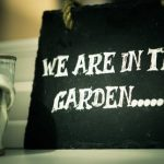 Chalkboard sign with We are in the Garden written on it